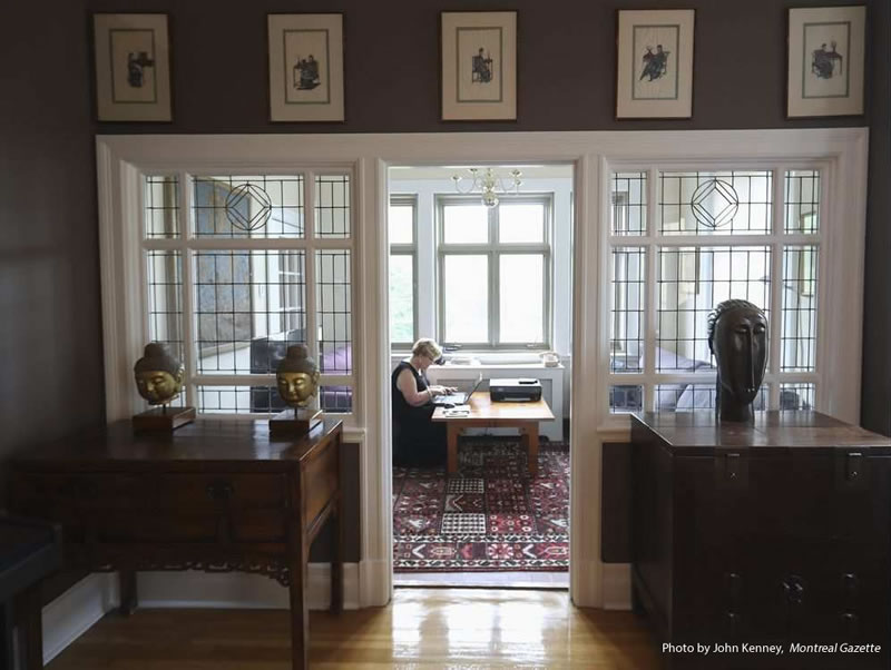 Pilar Shephard-Cumming works in a conservatory attached to the dining room at her apartment (John Kenney / Montreal Gazette)